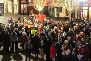 A crowd of around 200 people gathered to hear speakers at the front of Burlington City Hall on Monday, Nov. 28.