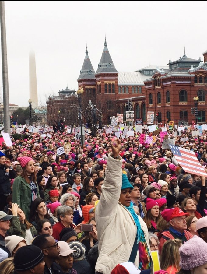 A+woman+raises+her+first+in+the+air+as+thousands+of+people+gather+for+the+Women%27s+March+on+Washington+on+Jan.+21.+The+event+took+place+the+day+after+the+Inauguration.+%7C+Photo%3A+Emma+Chaffee%2F+Register