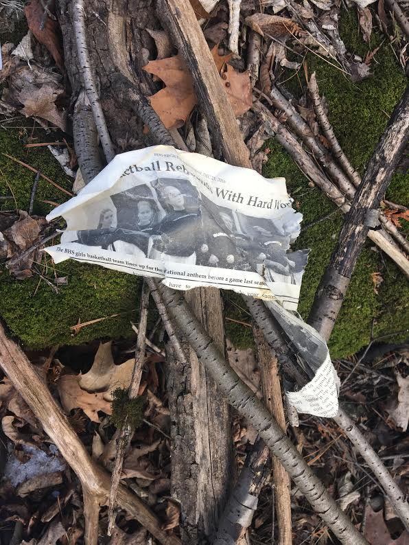 A torn up Register newspaper found in C-Woods | Photo Emma Chaffee/Register