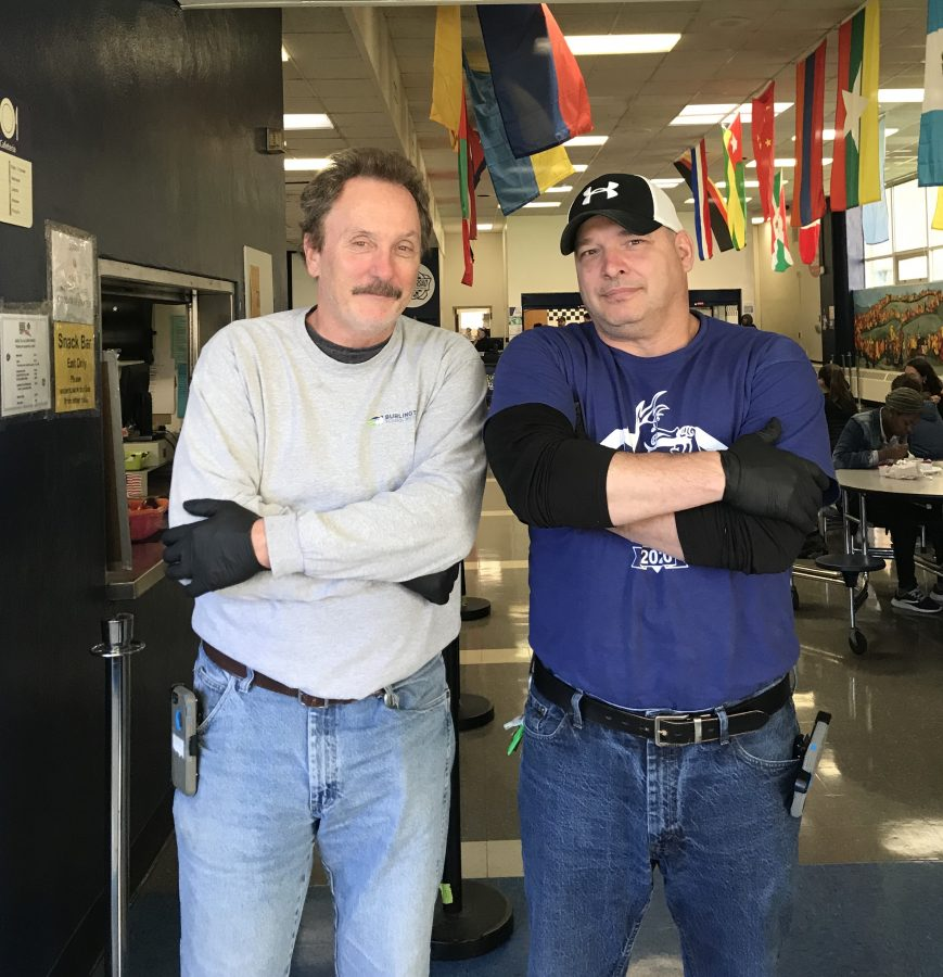 Photo: Nora Jacobsen Custodians Reed Richards and Warren Runnals strike a pose in the cafeteria.