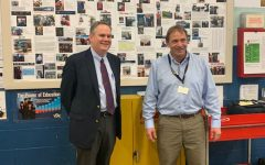 Photo: Courtesy of Bob Church//Automotive and Technology Instructor Bob Church and VT Secretary of Education Dan French in front of the BTC wall of fame
