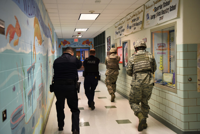 Photo: Courtesy Dover Air Force Base // A Dover Air Force squadron practices an active shooter drill in an elementary school in Dover, Delaware.