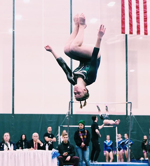 Photo%3A+Courtesy+of+Bridget+Haggerty%0ABridget+Haggerty+performs+her+floor+routine+in+front+of+a+panel+of+judges.+