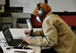 "BHS junior Nolan Simon records his podcast about ""Big"" John Van Hazinga. Photo: Charlie McConnell/Register"