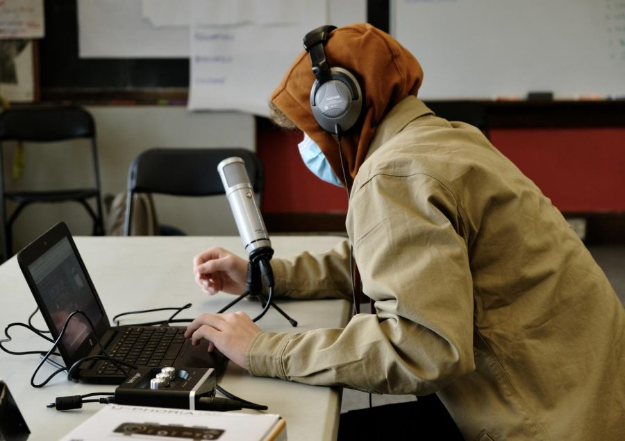 "BHS junior Nolan Simon records his podcast about ""Big"" John Van Hazinga. Photo: Charlie McConnell/Register"