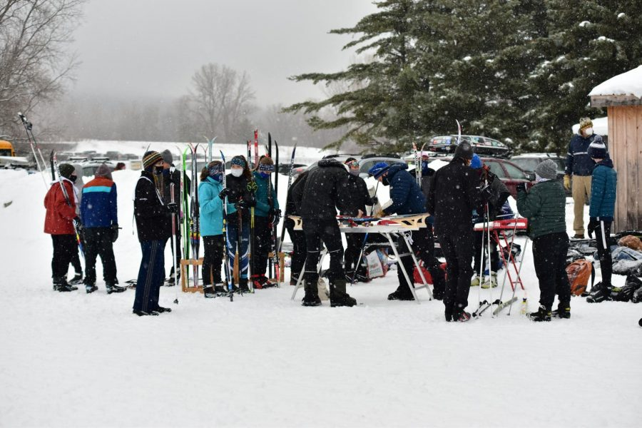 BHS nordic skiers wax their skis in preparation for a race against each other // Photo courtesy of Eric Hart