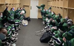 The Burlington/Colchester girls hockey team celebrating after winning quarterfinals. Photo: Keely Kostell