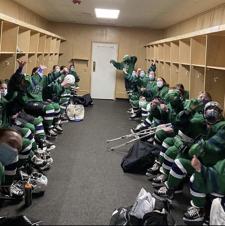 The+Burlington%2FColchester+girls+hockey+team+celebrating+after+winning+quarterfinals.+Photo%3A+Keely+Kostell