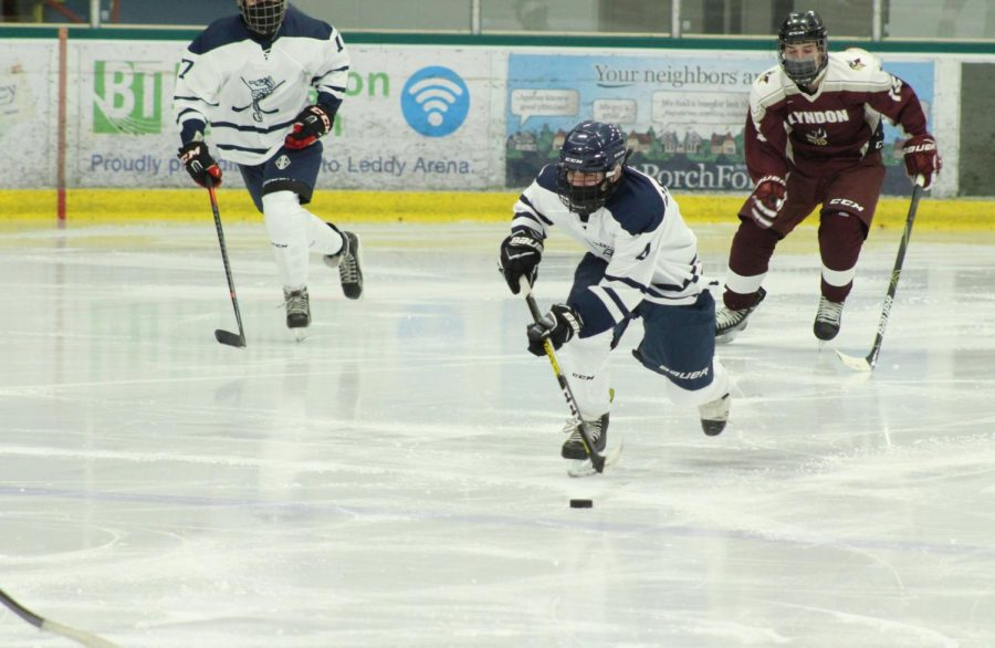Freshman Noah Rubman handles the puck in a game against Lyndon. Photo courtesy: Kat Rossman