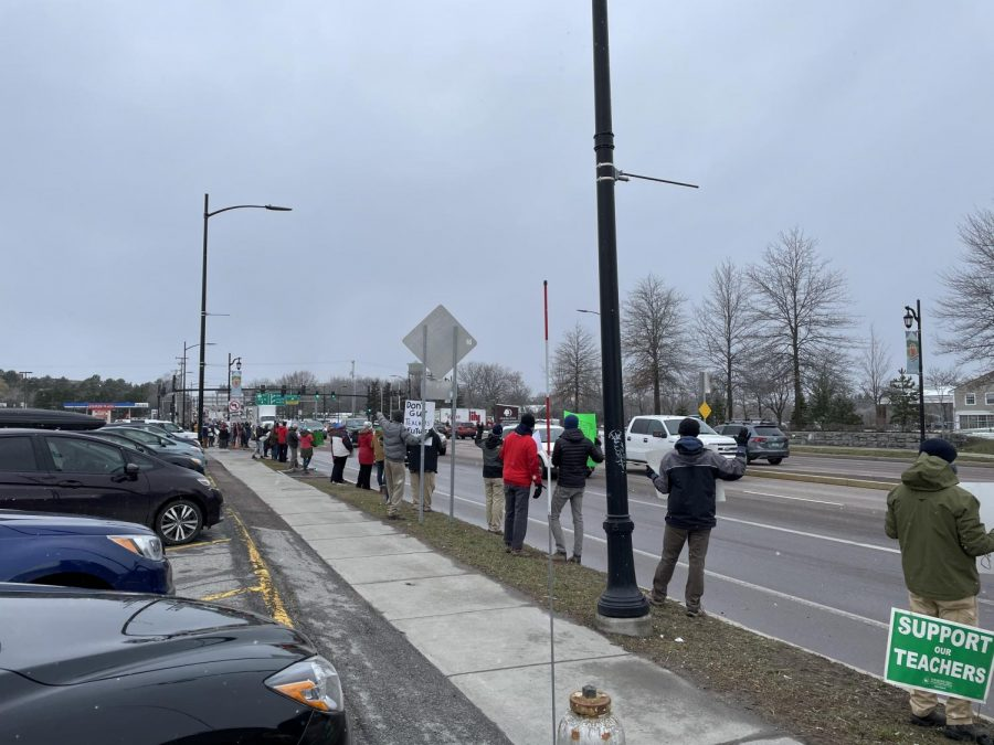 Teachers picket Williston Road on Thursday afternoon, April 1, in opposition to the proposed changes to the state pension system.