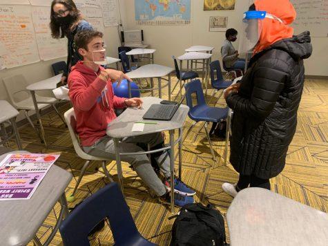 ASL Peer Tutor Grace Brown helping student. Photo: Owen Jolly.